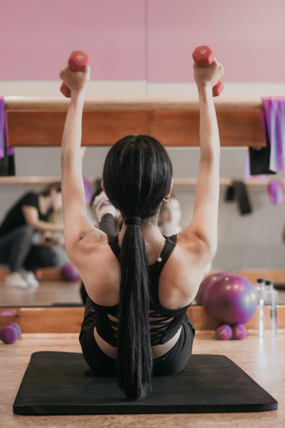 woman in black tank top and black shorts doing yoga