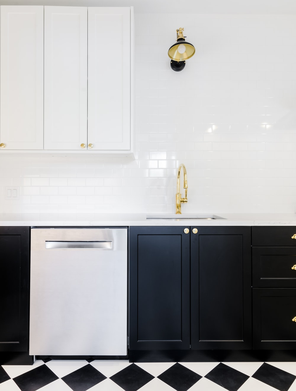 white wooden cabinet beside white wall