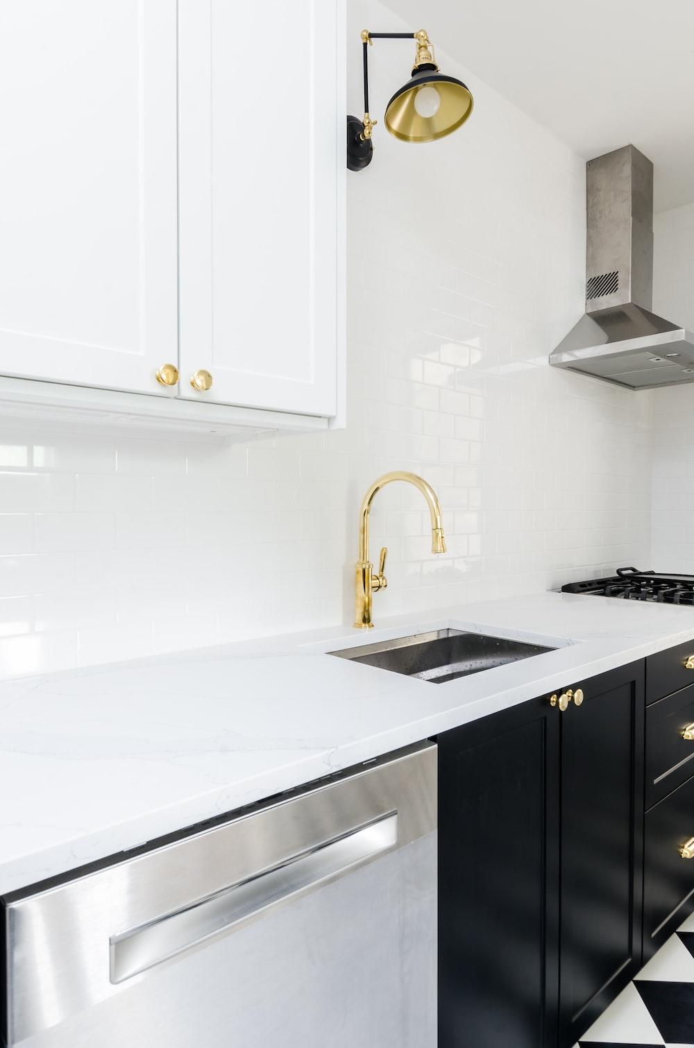white wooden kitchen cabinet near white wooden kitchen cabinet