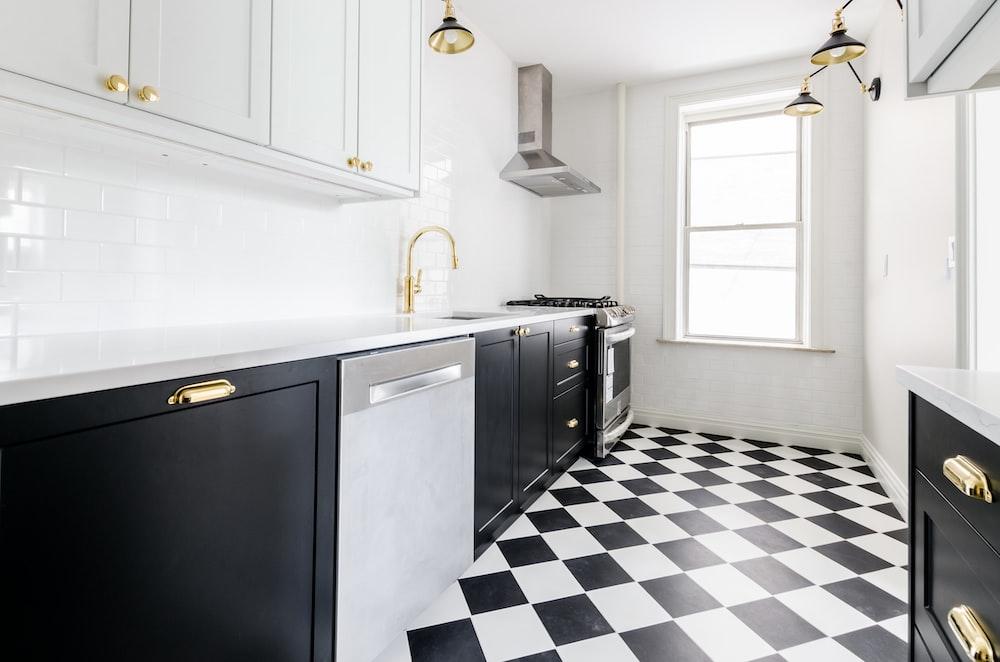 white wooden door near white wooden kitchen cabinet