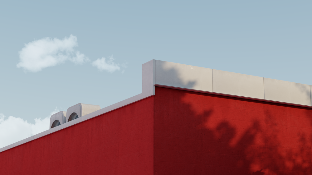 red and white concrete building under white clouds during daytime