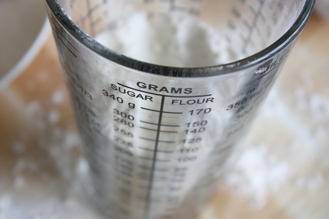 Close up on measuring glass for sugar and flour