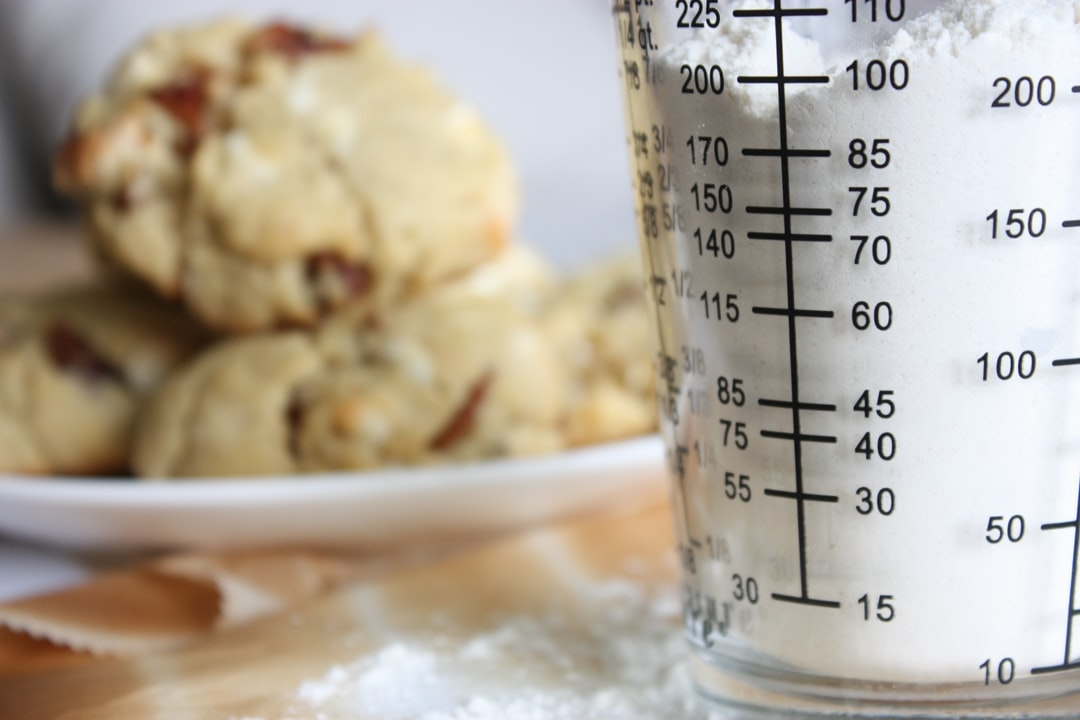 Measuring glass with flour in a kitchen