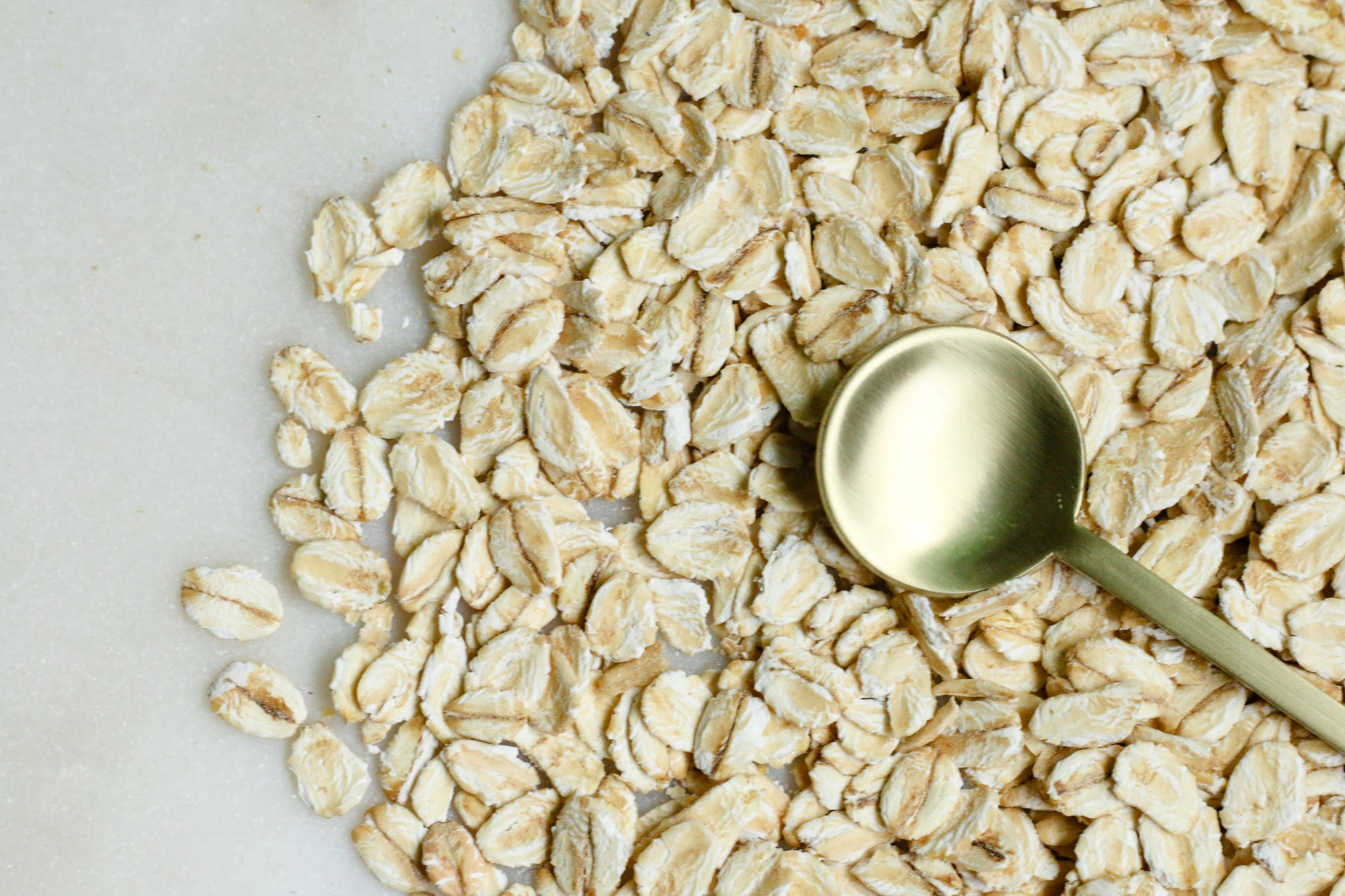 Oats on a  marble table, flat lay