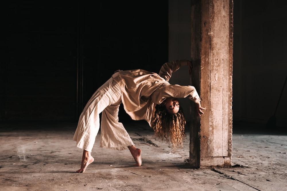 woman in white dress walking on gray concrete floor