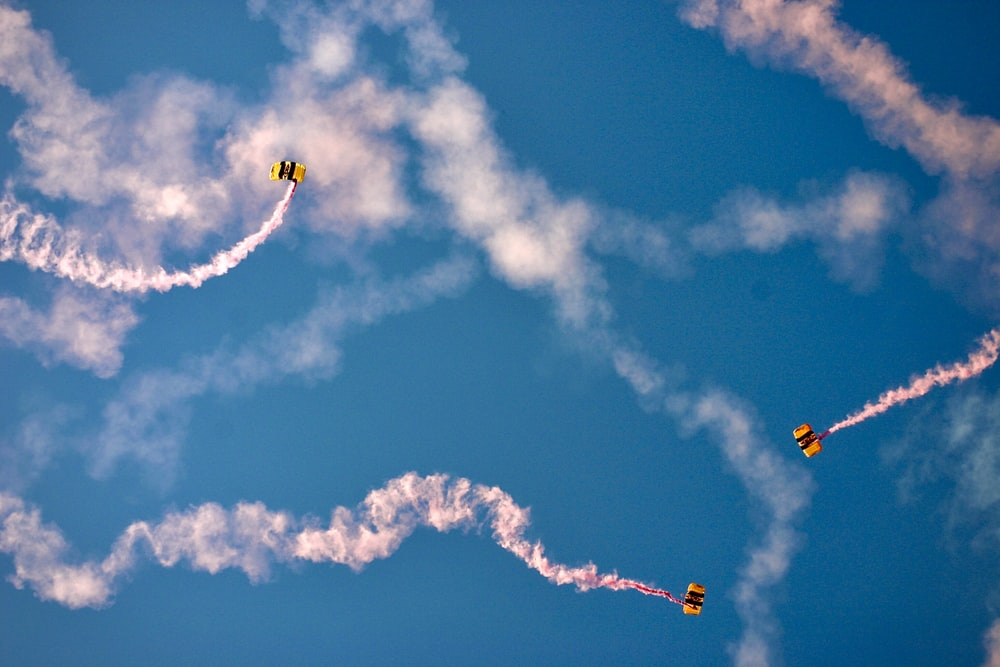 yellow and black plane in the sky