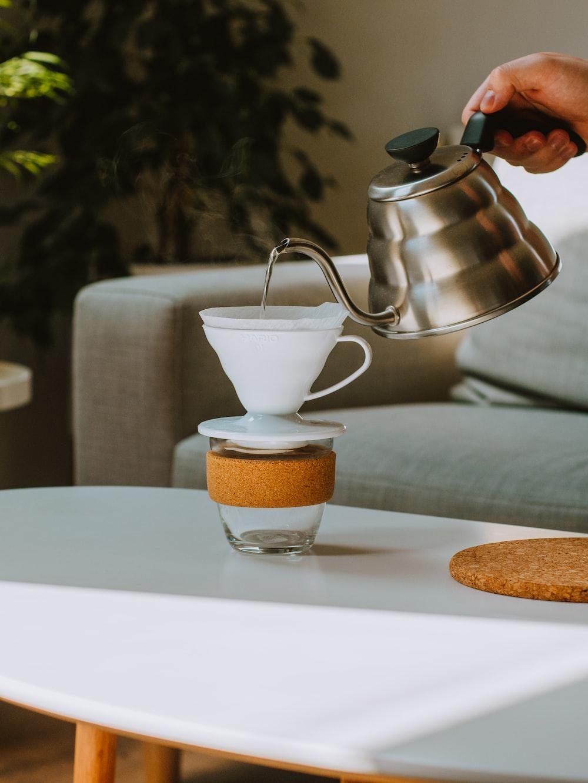 white ceramic teacup on white ceramic plate