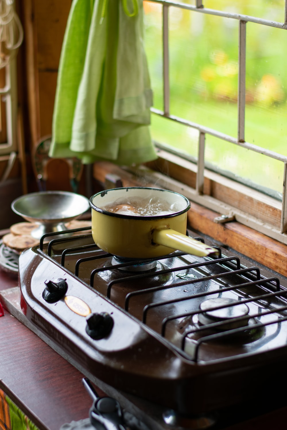 stainless steel cooking pot on gas stove