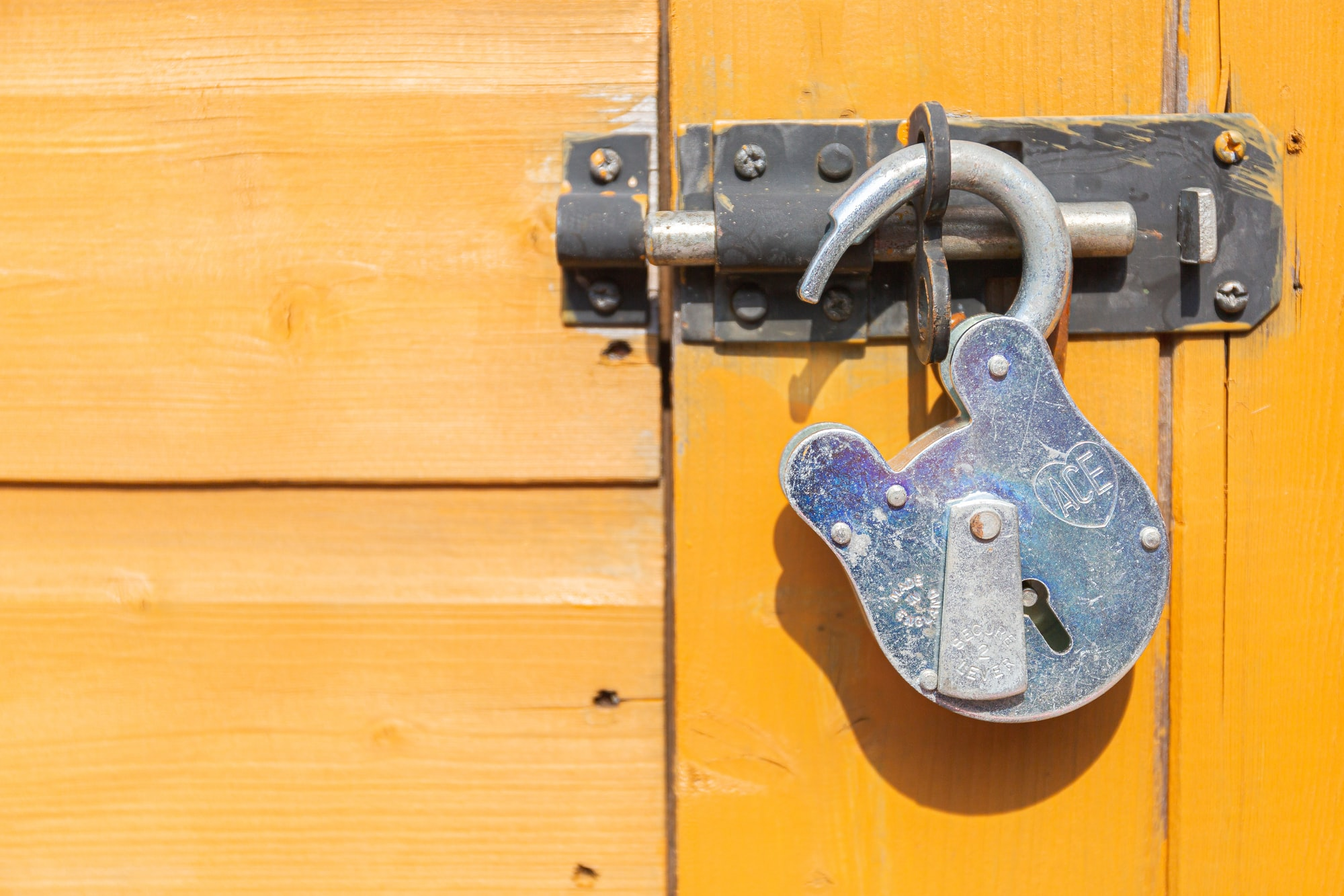 Unlocked old fashioned padlock. Just when will lockdown end?