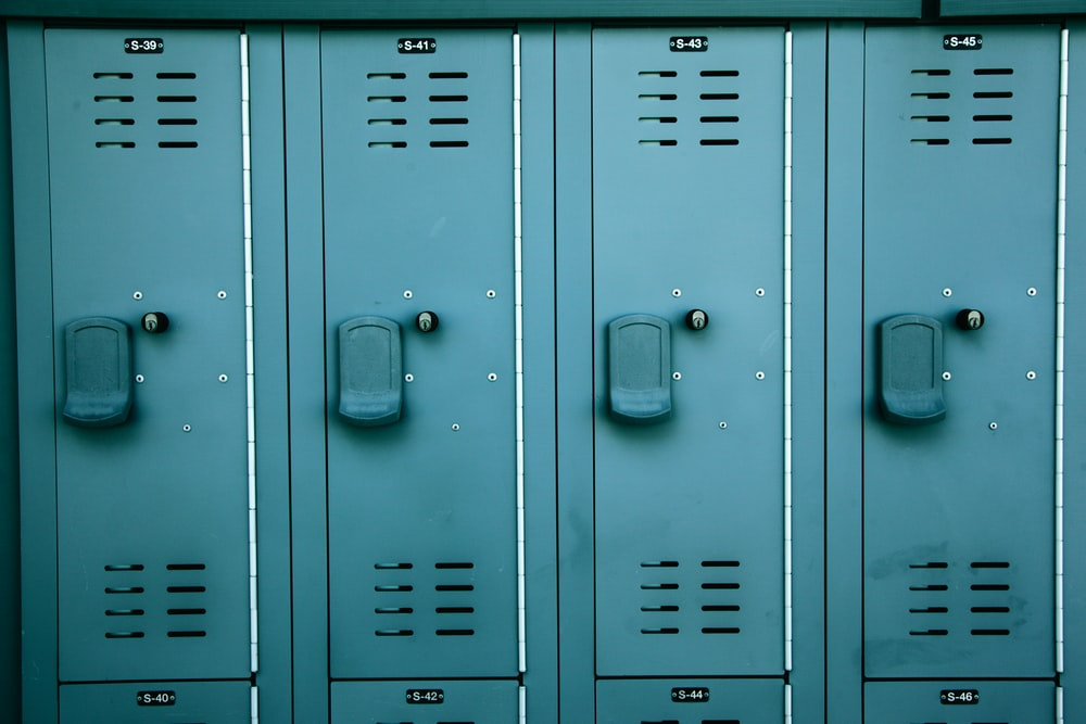 gray steel locker with padlock