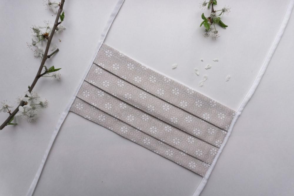 white flower on white ceramic tile