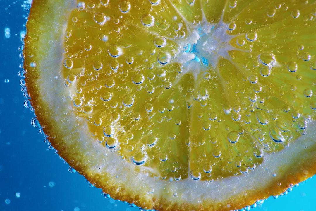 Orange in sparkling water, on a blue gradient