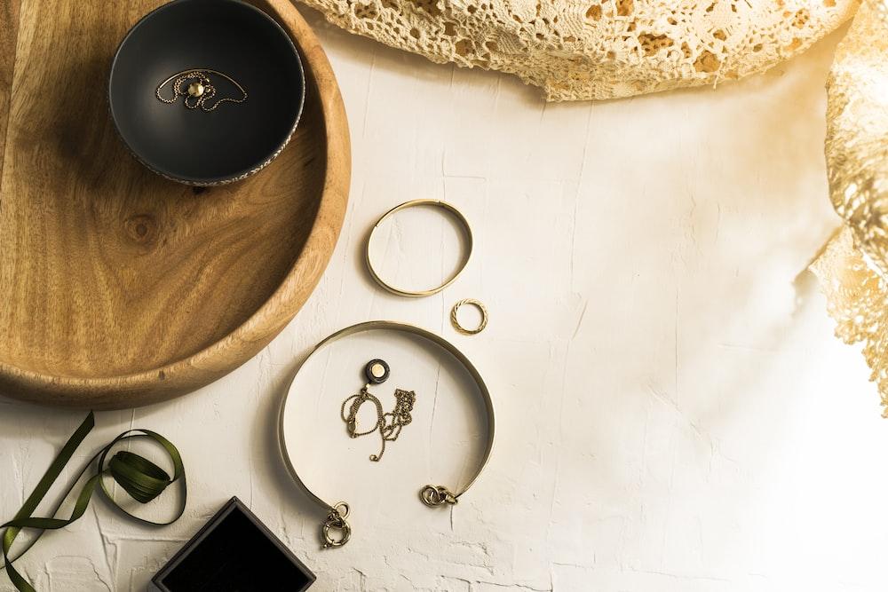 black ceramic mug on brown wooden round tray