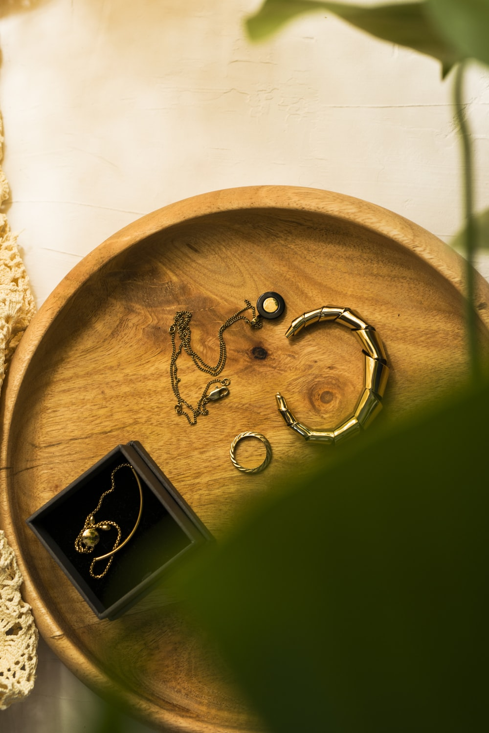 silver rings on brown wooden round table