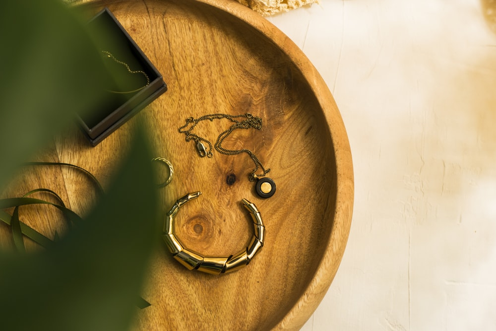 green and black smartphone on brown wooden round table