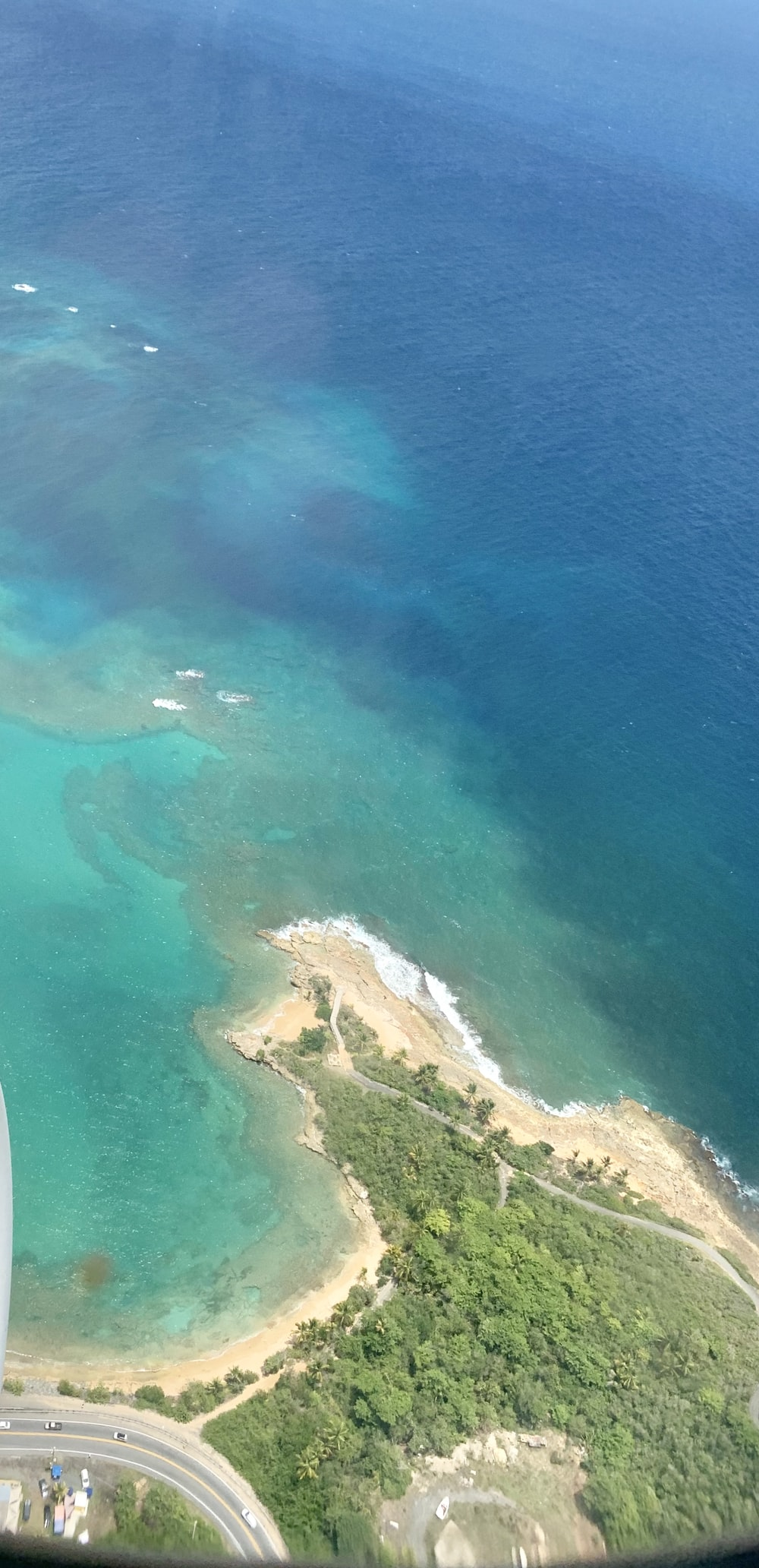 aerial view of green and brown island during daytime