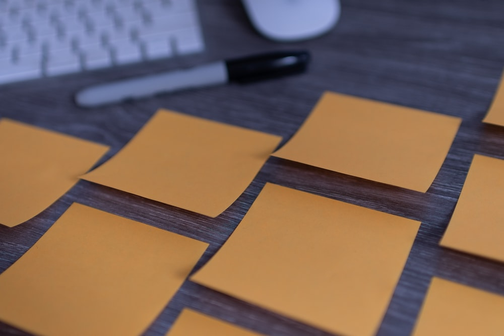 orange sticky notes on silver imac