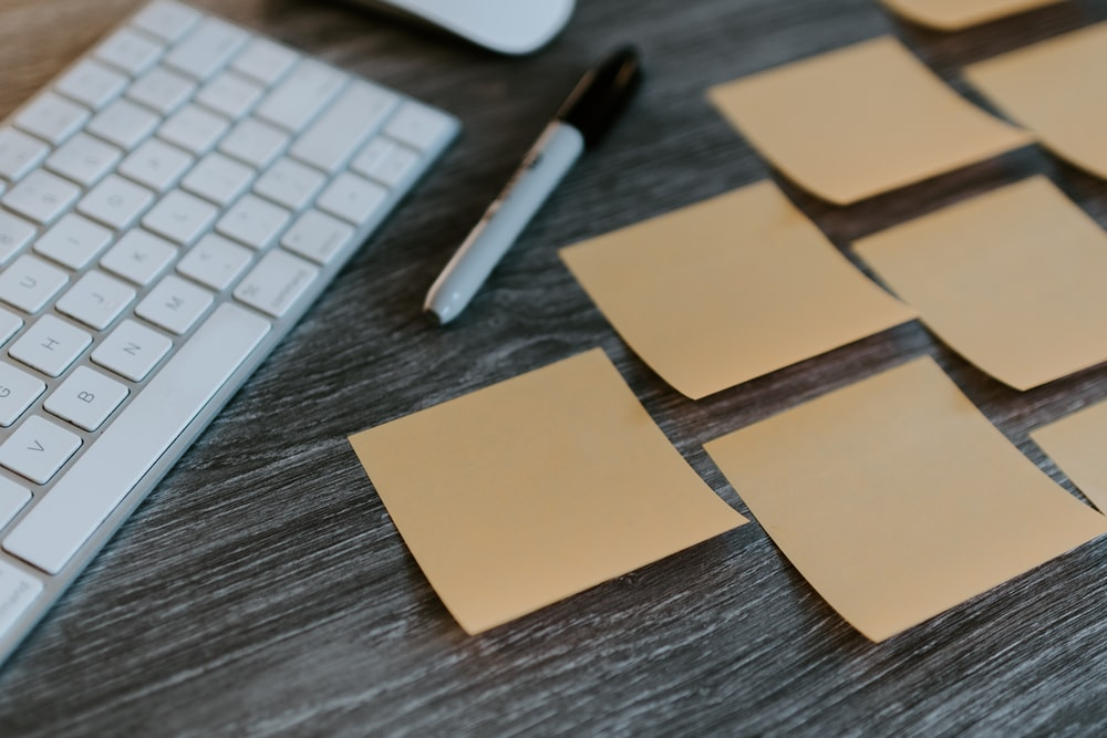 brown sticky notes on apple keyboard