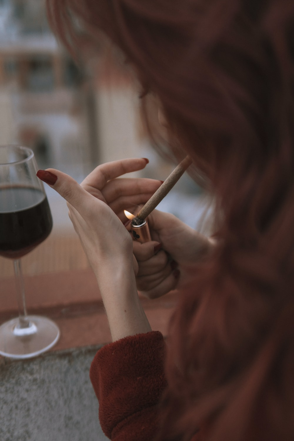 woman holding a wine glass