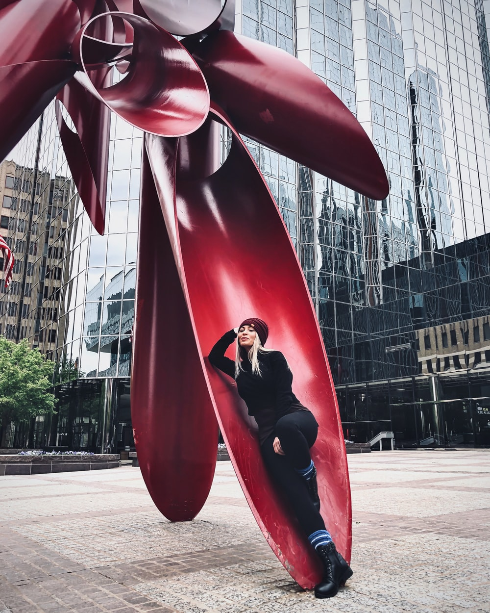 red and black statue near building during daytime