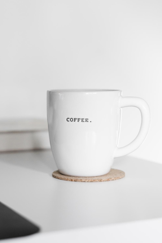 white ceramic mug on brown wooden coaster