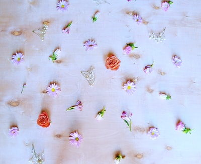white green and red floral textile