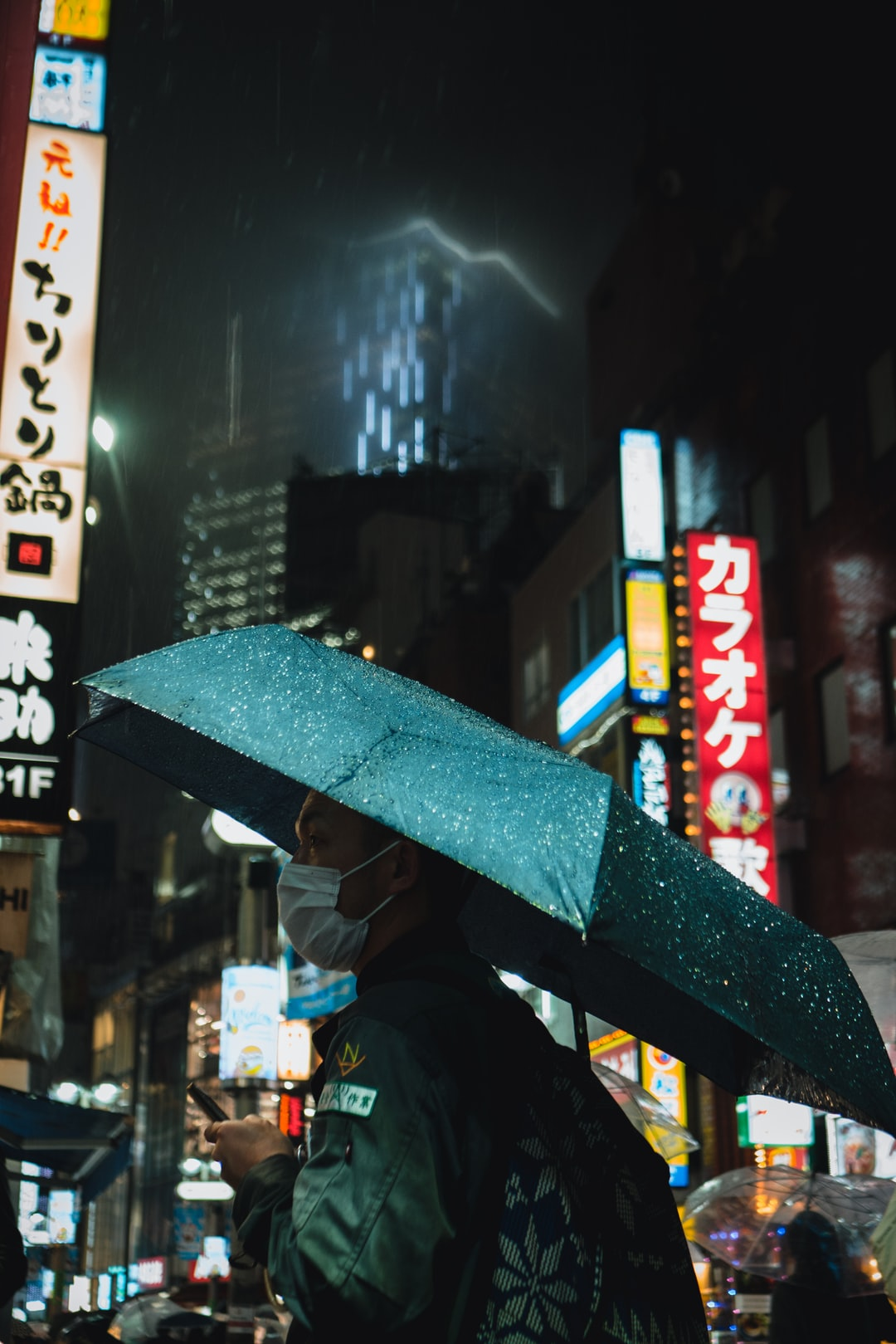 Man using an umbrella in Shibuya in the rain