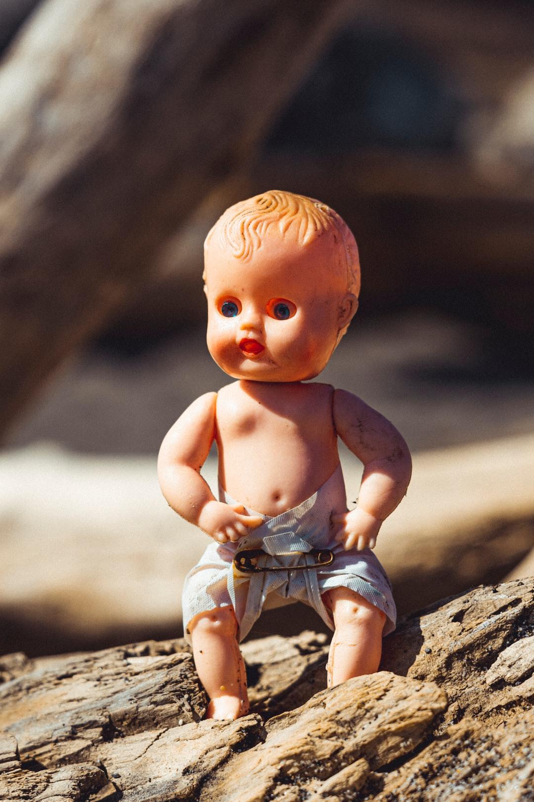 doll on log.