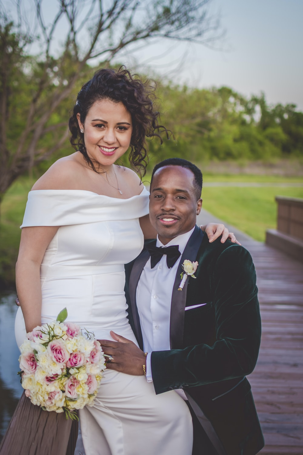 Man In Black Suit Jacket Holding Woman In White Wedding Dress Photo Free Apparel Image On Unsplash,Casual Outdoor Wedding Dress Ideas