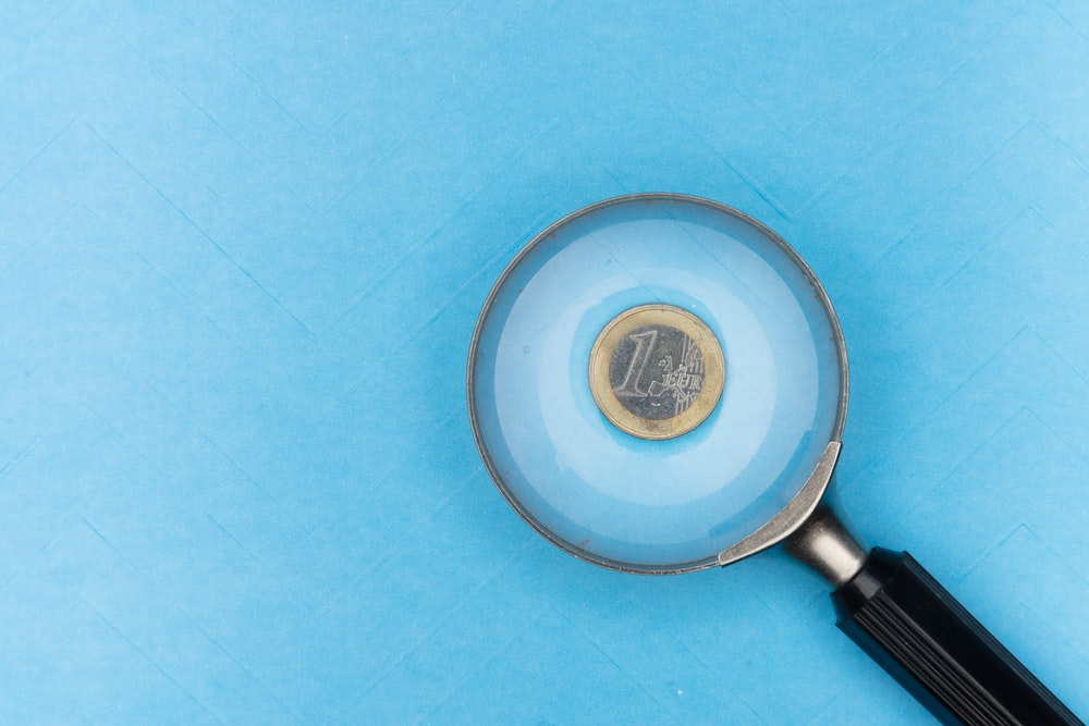 round grey and black magnifying glass