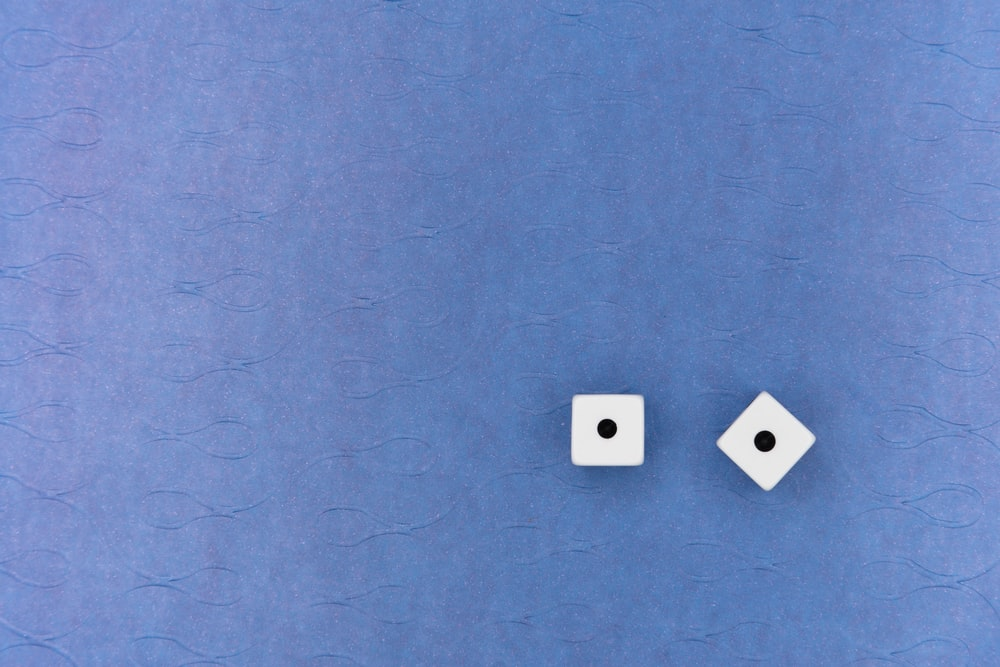 white wall mounted switch on blue wall