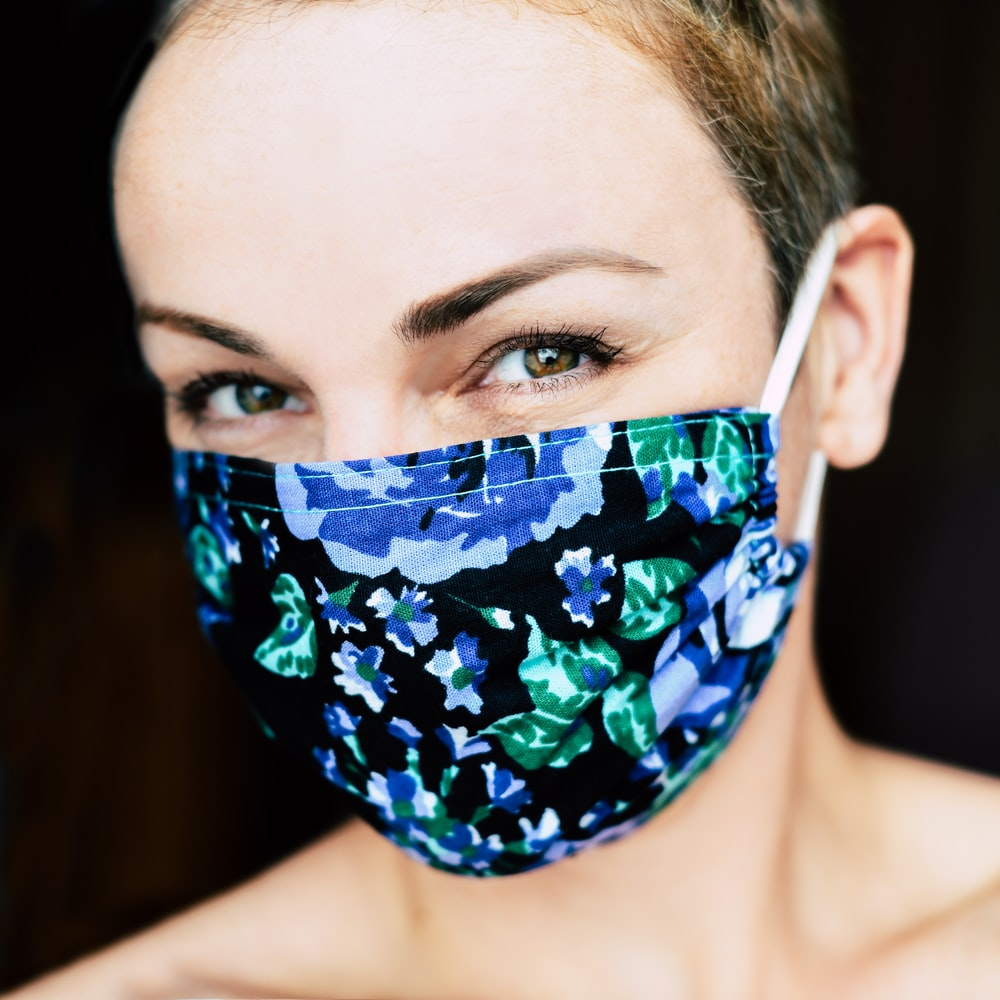 woman with blue and black floral face paint