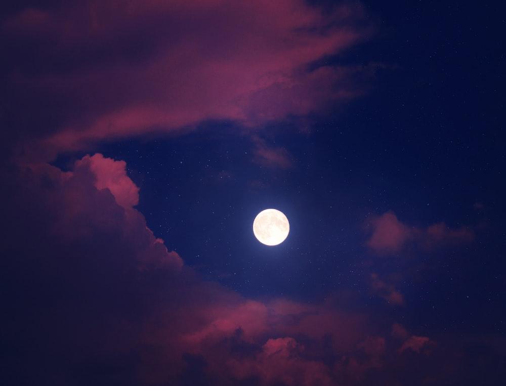 full moon over dark clouds