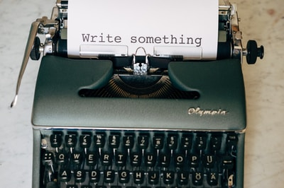 black and white typewriter on green table