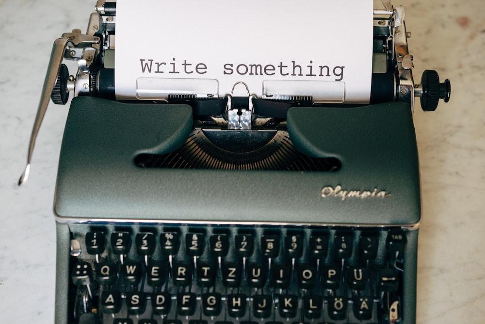 black and white typewriter on green table