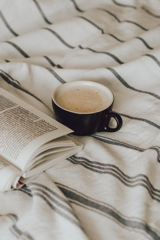 black ceramic mug on book page