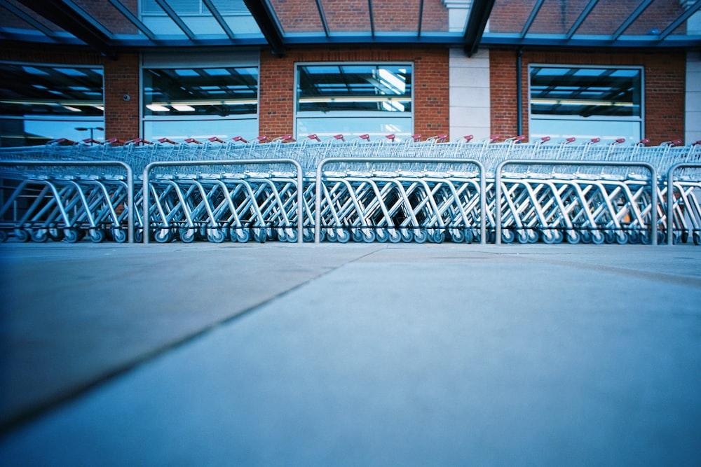 blue metal railings on white floor tiles