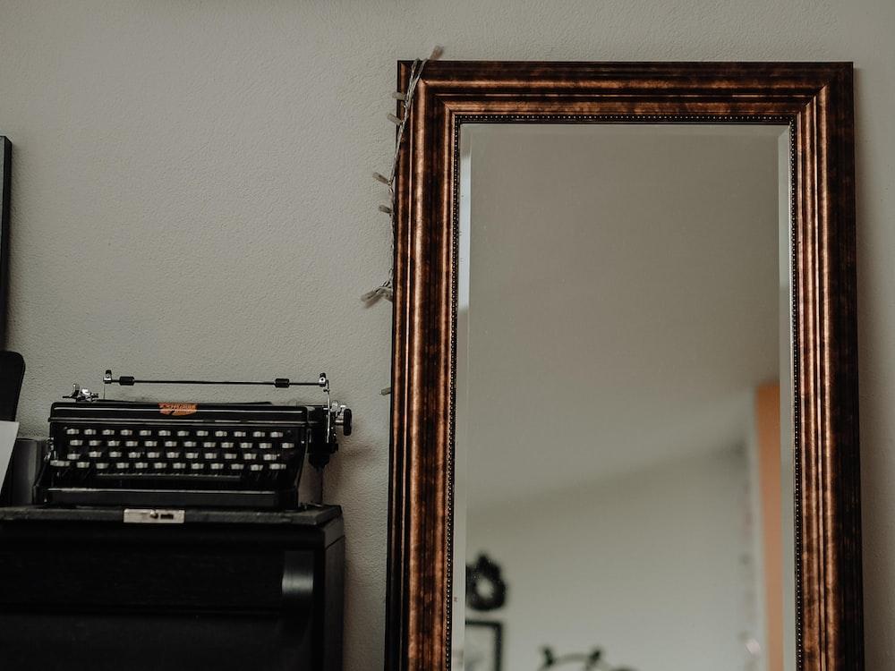 black typewriter on brown wooden table