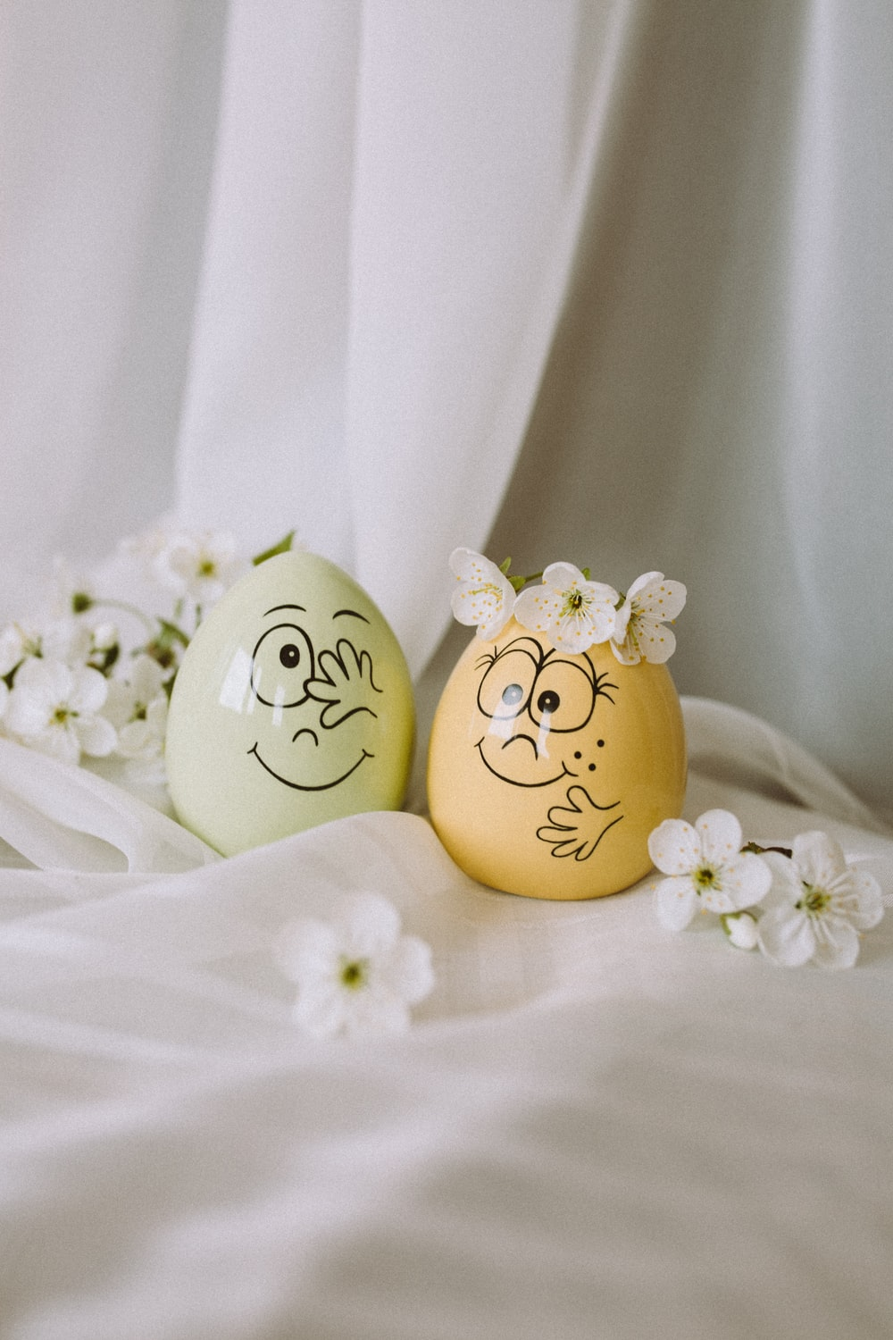 white and yellow floral egg ornament