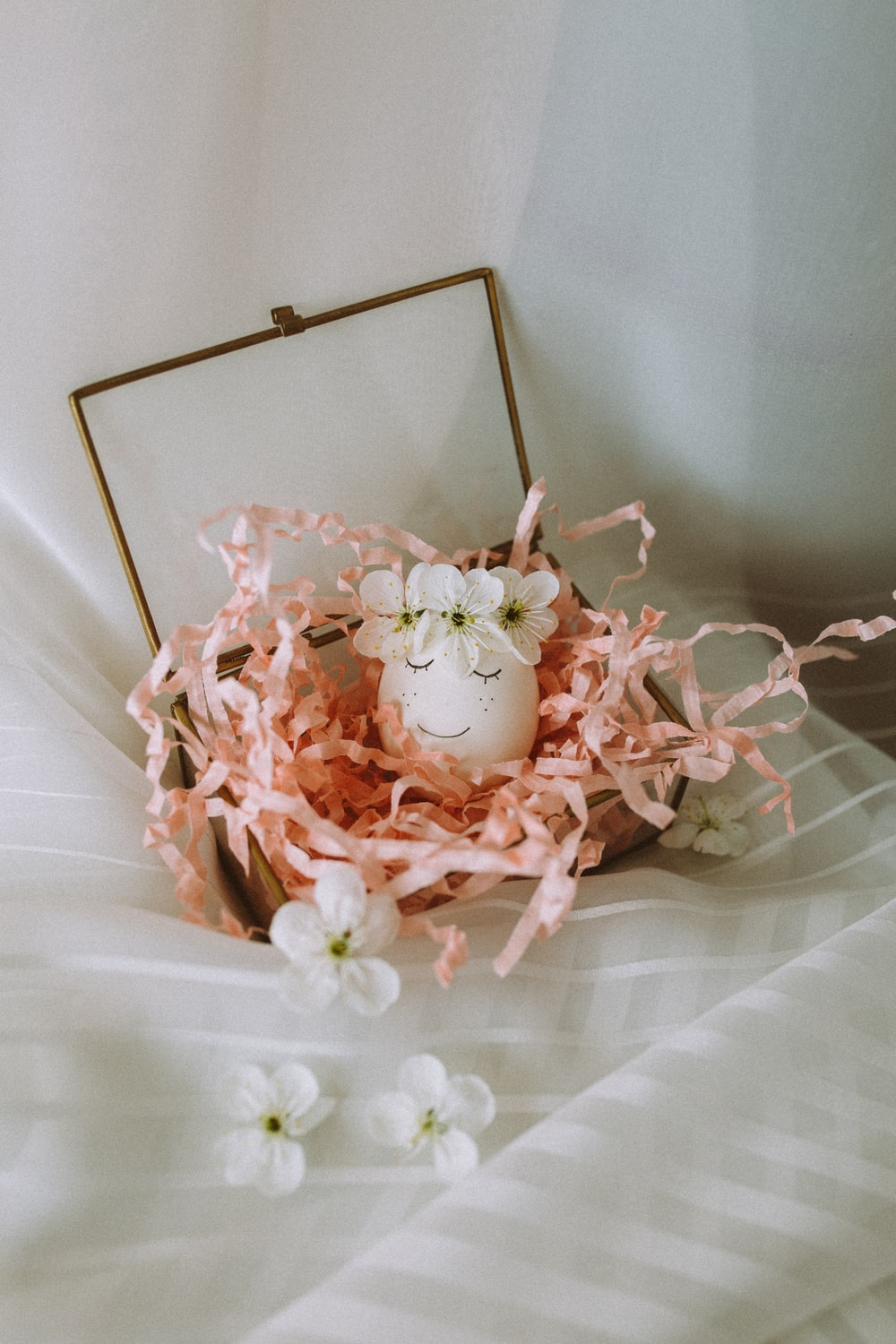 pink rose bouquet on white textile