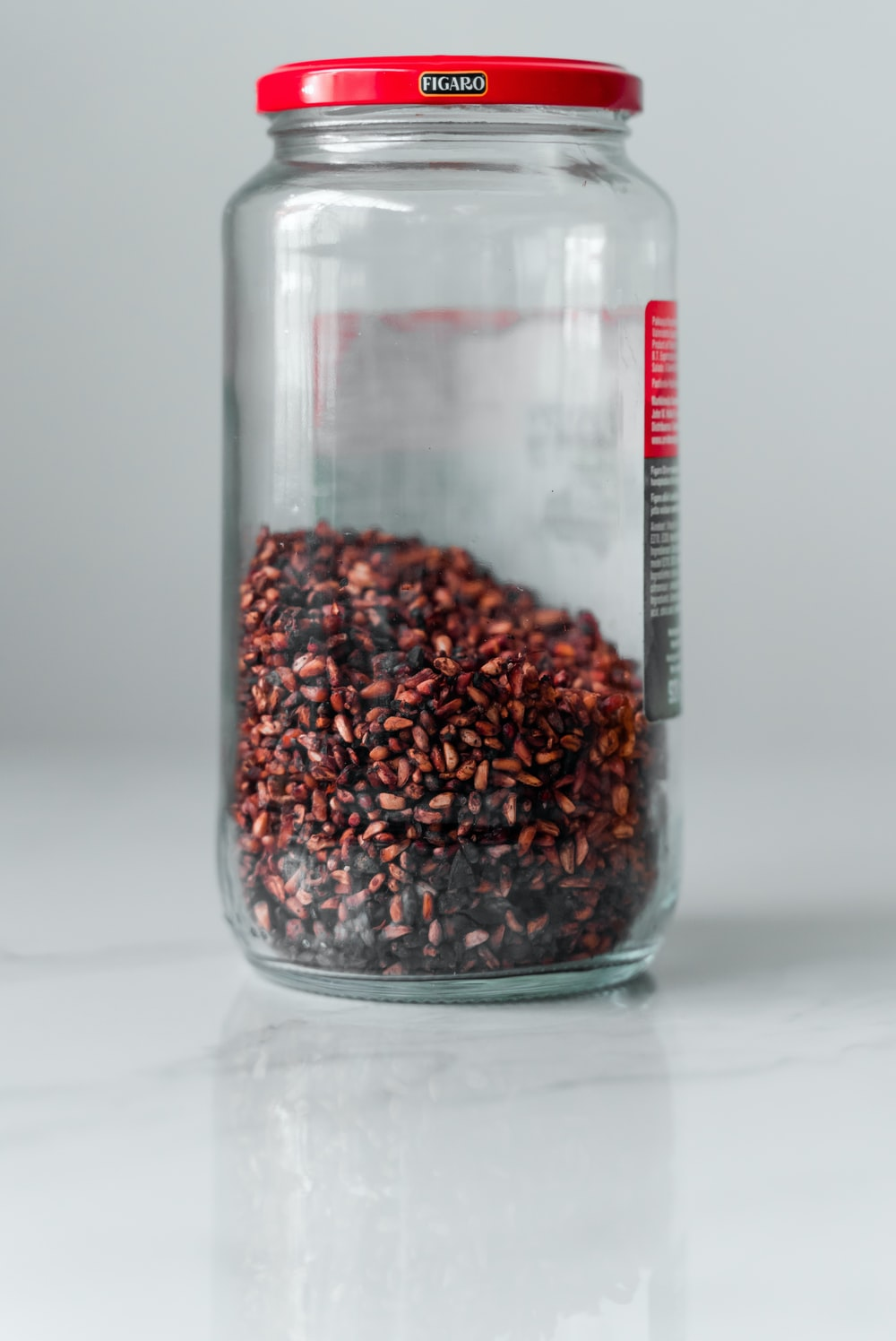 brown beans in clear glass jar