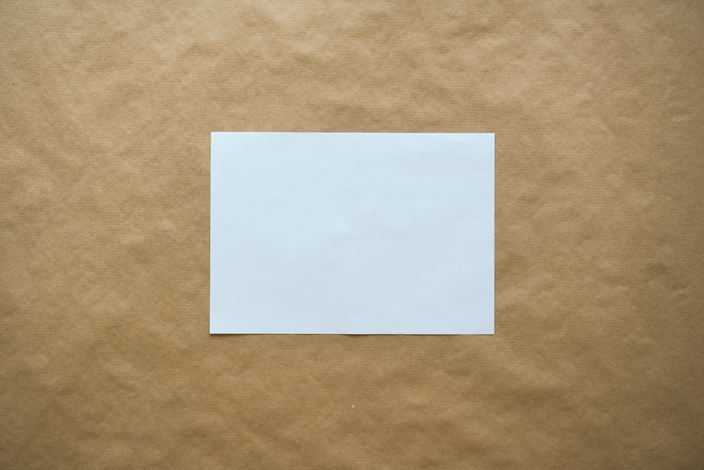 white paper on brown surface