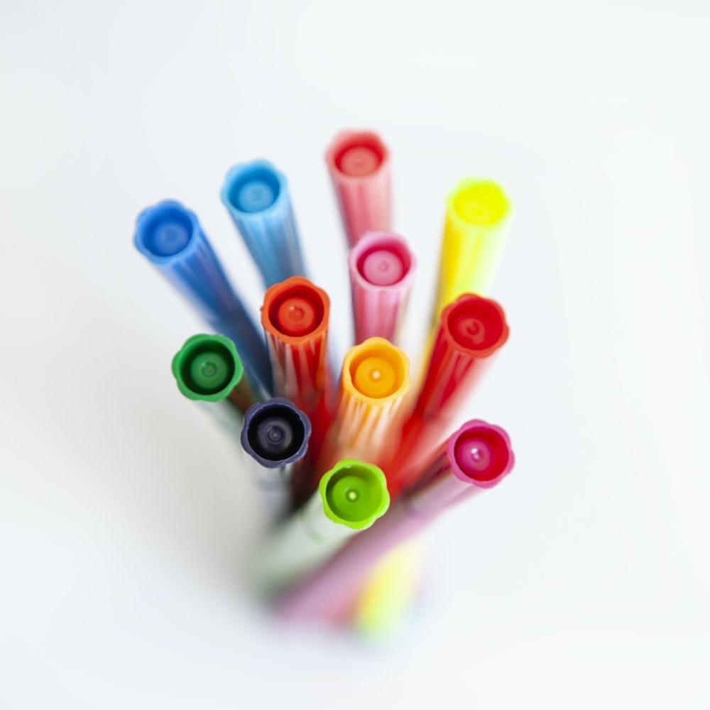multi colored pen on white background