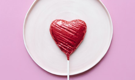 red lollipop on white ceramic round plate