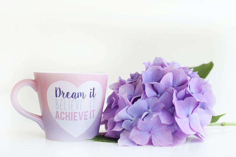 purple tulips in white ceramic mug
