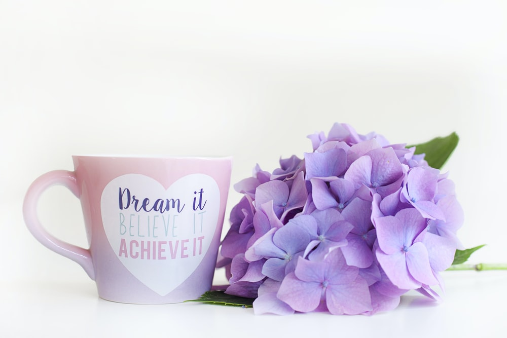 purple tulips in white ceramic mug
