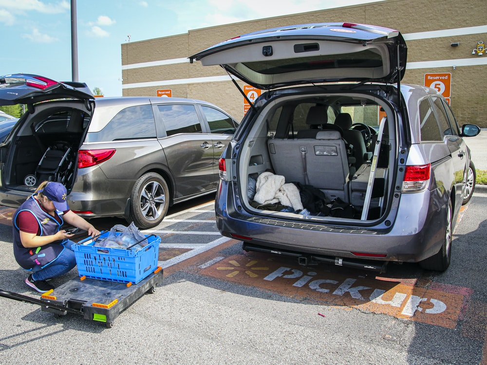 silver suv with blue plastic crate