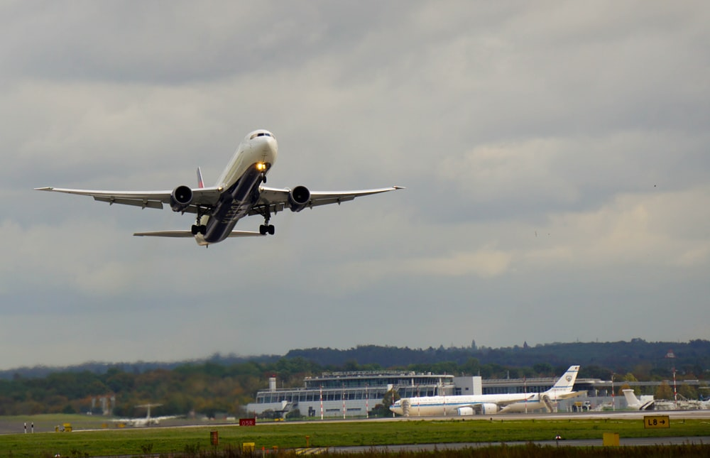 white airplane on airport during daytime