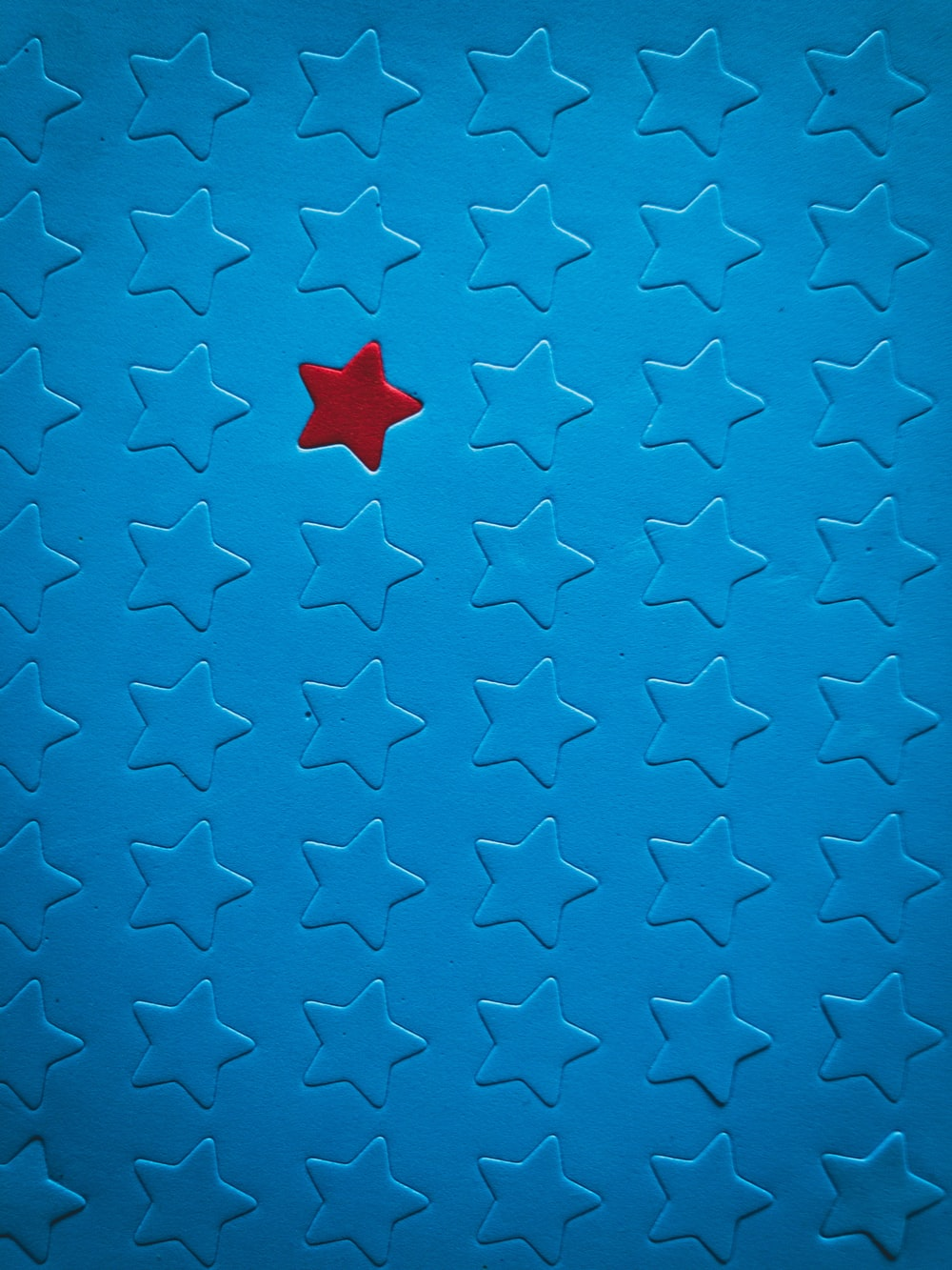 blue and white star print textile