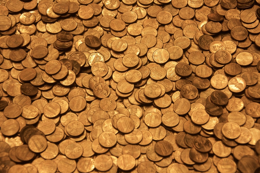 brown round coins on brown wooden surface